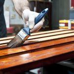 Varnishing wooden boards